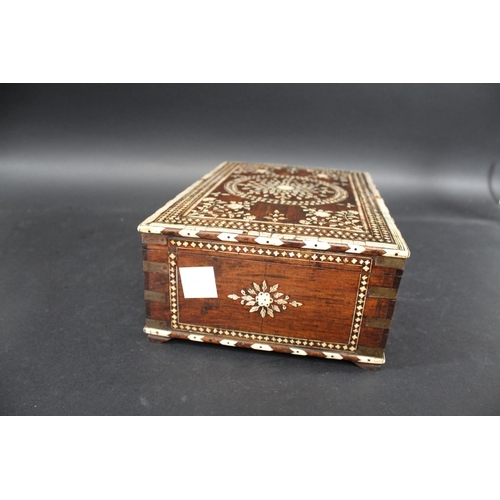 1690 - ANGLO INDIAN IVORY INLAID BOX a late 19thc hardwood rectangular box, inlaid in ivory and bone with v...