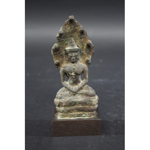 1695 - KHMER BRONZE BUDDHA - CAMBODIA a Khmer Naga enthroned buddha, Cambodian and possibly circa 12thc AD....