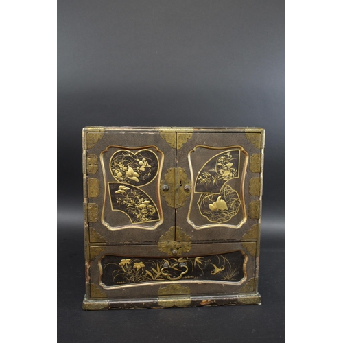 1723 - JAPANESE LACQUERED TABLE CABINET a late 19thc lacquered and brass bound cabinet, each side including...