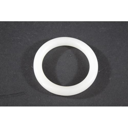 1745 - CHINESE JADE BANGLE a plain white jade bangle, 7.5cms diameter