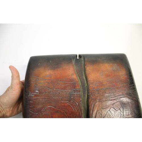 1573 - PETER HAYES (B 1946) - LARGE RAKU KEYHOLE SCULPTURE a red and black burnished and textured raku key ...