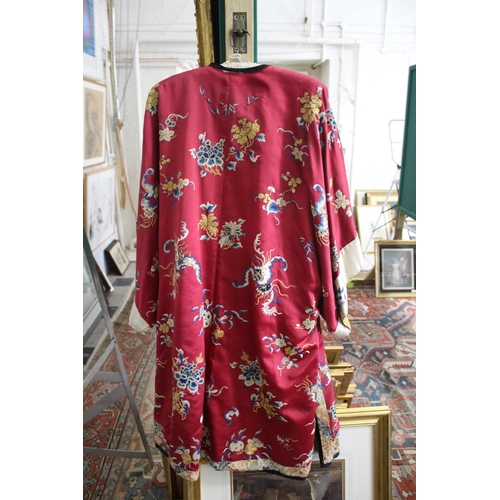 1704 - CHINESE SILK ROBE of red silk, decorated with silk and couched metallic thread embroidered images, c...