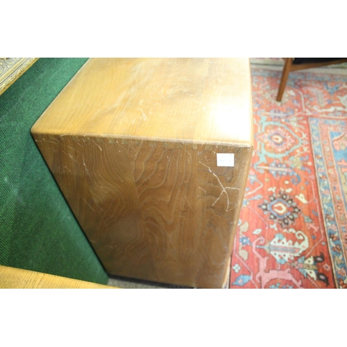 1506 - ERCOL DINING ROOM SUITE comprising a light elm sideboard with a two door cupboard, and a single cupb...