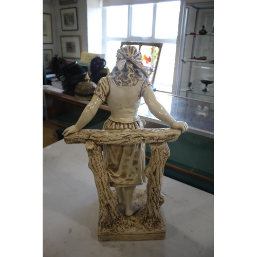 1570 - LARGE BRETBY GARDEN FIGURE  an unusually large cream glazed pottery figure of a lady, with arms supp...