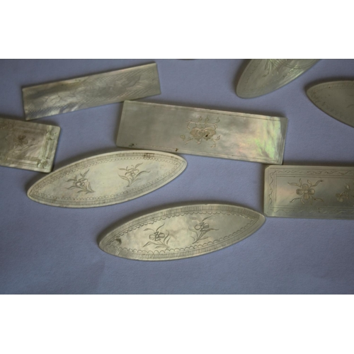 1746 - CHINESE MOTHER OF PEARL COUNTERS approx 135 mother of pearl counters in a variety of shapes, in a 19...