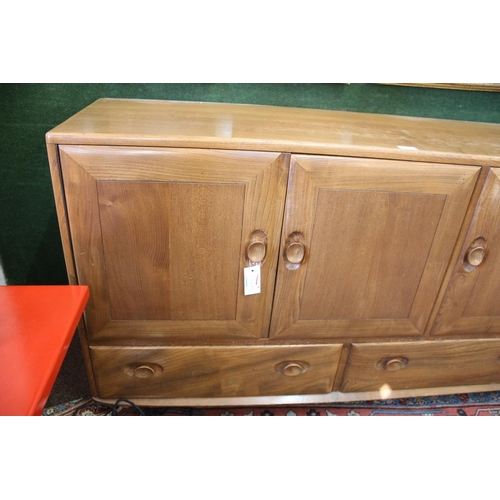 1505 - ERCOL SIDEBOARD a light elm sideboard with a two door cupboard with shelf, and a single cupboard wit...