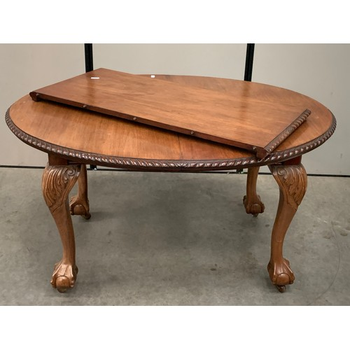 648 - WIND OUT DINING TABLE WITH HEAVY CABRIOLE LEGS, BALL AND CLAW FEET AND CASTERS...