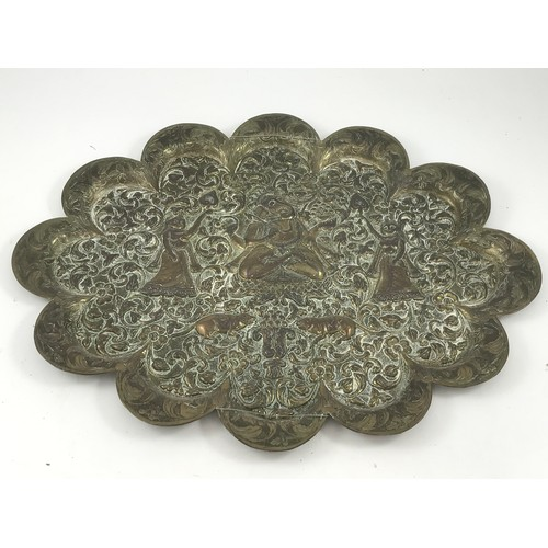 1775 - INDIAN BRASS TRAY OF LOBED FORM WITH HEAVILY EMBOSSED DECORATION...