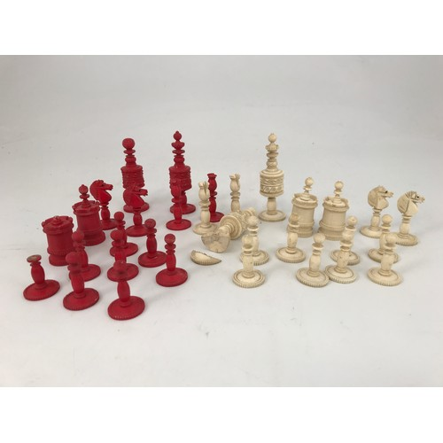 1815 - 19th CENTURY CARVED RED AND WHITE STAINED CHESS SET...