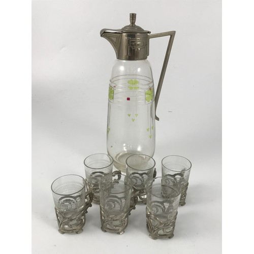 1866 - ART NOUVEAU LIQUEUR JUG AND 6 ETCHED GLASSES IN METAL GLASS HOLDERS...