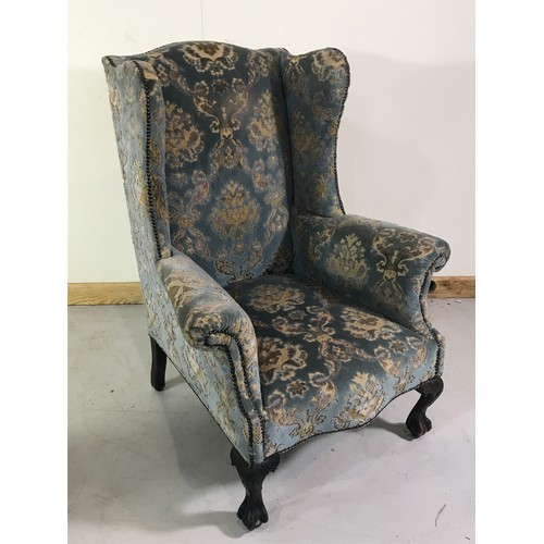 1046 - UPHOLSTERED WING BACK STYLE ARM CHAIR ON BALL AND CLAW FEET