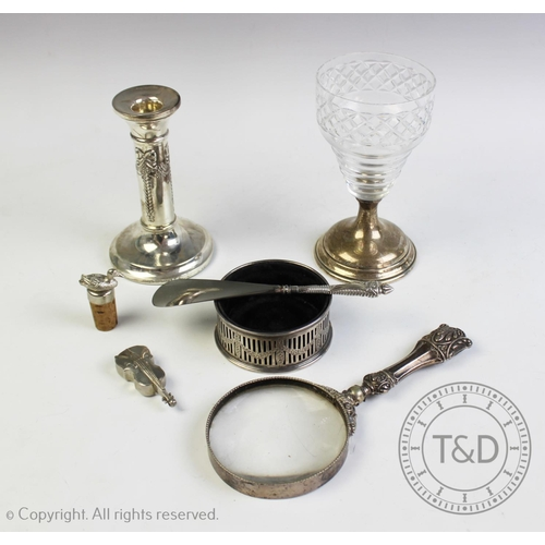 52 - A selection of silver and silver coloured items, comprising; an Edwardian silver bottle coaster, Sto...