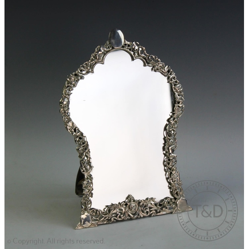 59 - A Victorian silver mirror, Edward Brown, London 1885, designed as a pierced design frame, interspers...
