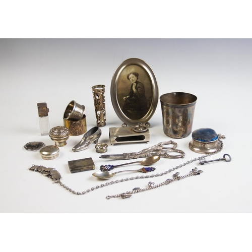 25 - A selection of silver and silver coloured wares, to include; a Chester silver match sleeve, a cased ...