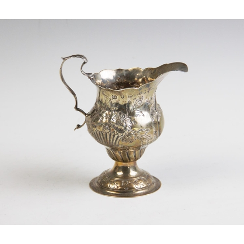4 - A George III silver milk jug, probably Thomas Shepherd, London 1769, of typical pedestal form, later...