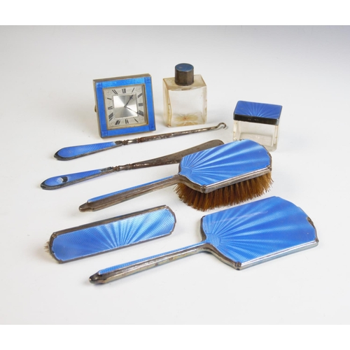 40 - An Art Deco harlequin dressing table set, each piece with silver mount and blue guilloche enamel, co...