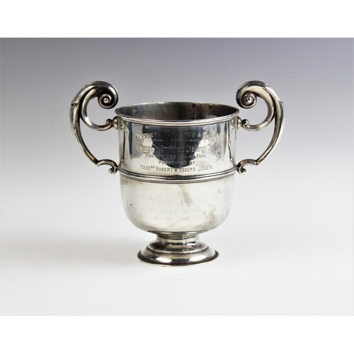 1 - A George V two handled silver presentation trophy, Chester 1912, of plain polished band design, with...