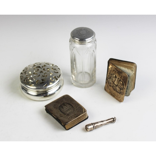 16 - A collection of silver, comprising; a Victorian silver topped vanity jar, London 1858, an Edwardian ...