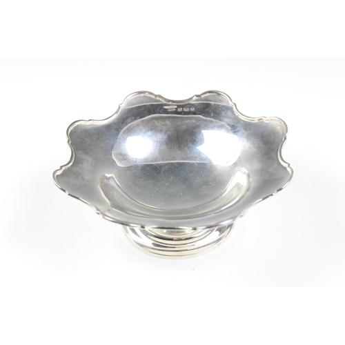 3 - A George V silver pedestal bowl, Docker & Burn Ltd, Birmingham 1923, with a cast cusped rim, 16cm di...
