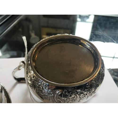 2 - An Edwardian silver three piece service, C S Harris & Sons Ltd, London 1905, comprising; a teapot, 1...