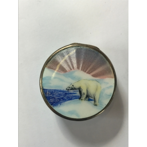 21 - A Norwegian silver and enamelled circular box, the cover depicting a polar bear against a radiating ...