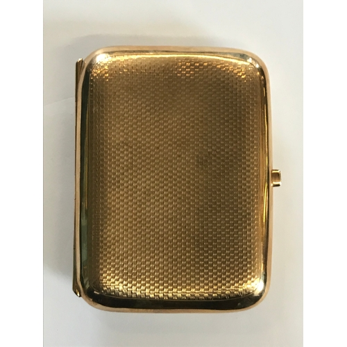 17 - A 9ct yellow gold cigarette case, Birmingham 1926, of rounded rectangular form, with engine turned d...