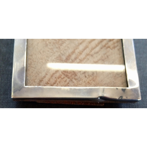 34 - A George V silver photograph frame, William Neale & Son, Birmingham 1911, with ribboned reeded borde...