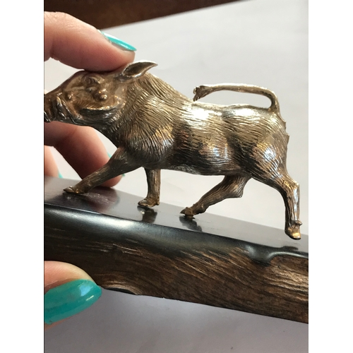 13 - A silver model of a Warthog family by Patrick Mavros (African), depicted on a carved hardwood base, ...