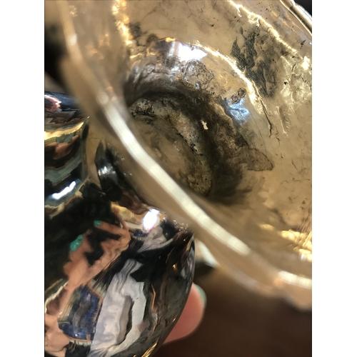 11 - A George III silver cream jug, Edward Sawyer, Birmingham 1777, the jug of baluster form with cusped ...