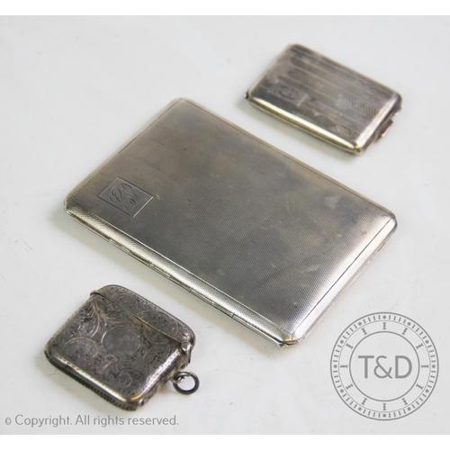 13 - A 20th century silver cigarette case, W T Toghill & Co, Birmingham 1944, with engine turned decorati...