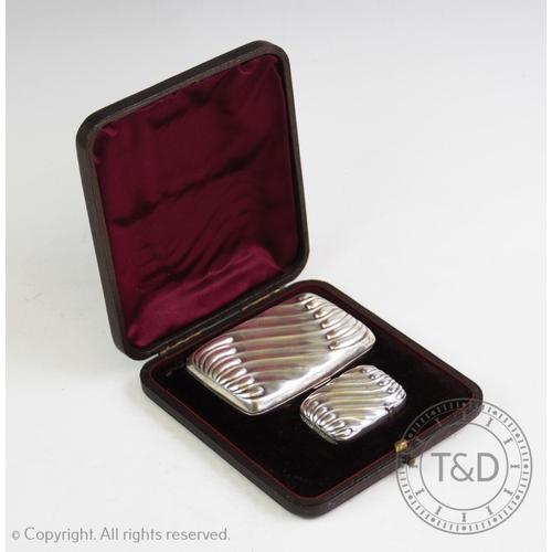 17 - A Victorian gentleman's silver smoking set, Henry Bourne, Birmingham 1893, comprising: a silver ciga...