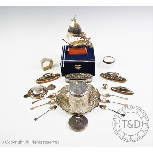 36 - A selection of silver and silver coloured items to include, a white metal ship, on a wooden stand, a...