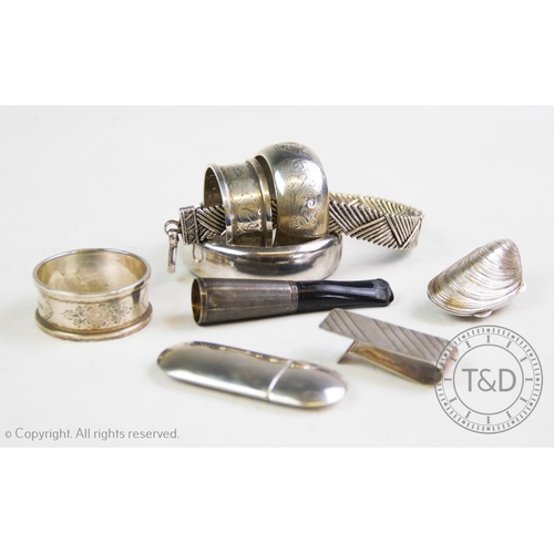 40 - A selection of silver and silver coloured items, comprising: a silver hinged bangle, C P S Jewellery...