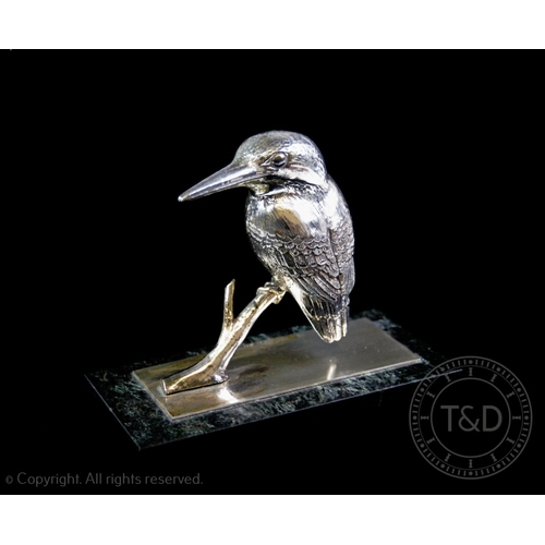43 - A white metal model of a kingfisher, mounted on a silver base plate, plate hallmarked London 1980, a...