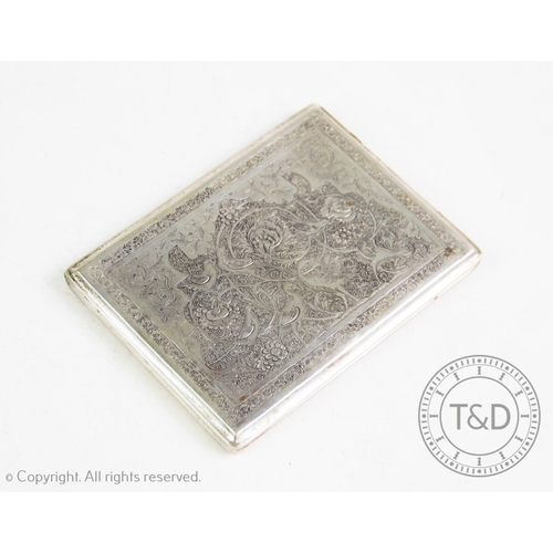7 - A 19th century Indian silver cigarette case, of rectangular form, elaborately chased with formal flo...