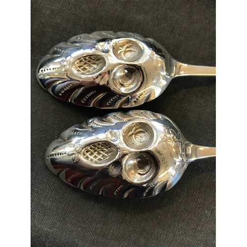 52 - A boxed pair of pierced silver dishes by SJ Lever & Co, Birmingham 1934, cusped border with pierced ...