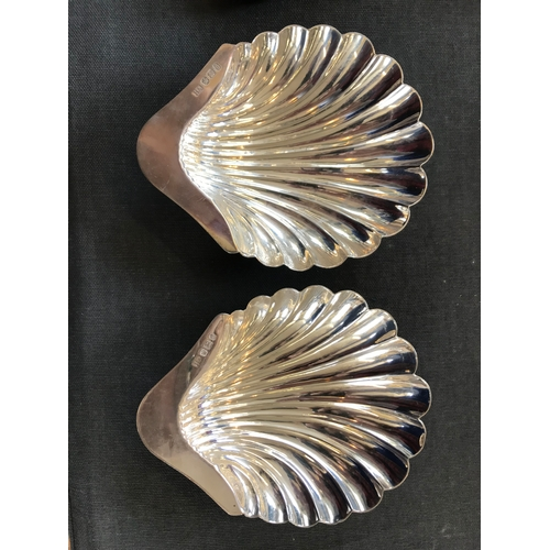 58 - A pair of Victorian silver salts, Atkin Brothers, Sheffield 1896, of shell form, on three ball feet,...
