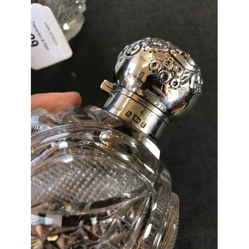 29 - A pair of Victorian silver mounted cut glass scent bottles, John Grinsell & Sons, Birmingham 1900, o...