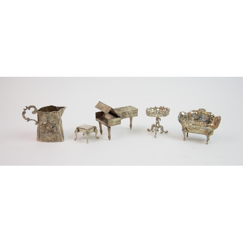 12 - A selection of continental silver, comprising: a Victorian imported silver cream jug, London 1894, w...