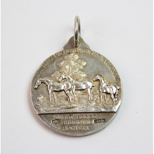 14 - A George V silver medal, Frank Hyams Ltd, Birmingham 1912, inscribed 'Hunters Improvement & National...