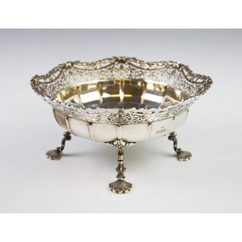 18 - A George V silver dish, Adie Brothers Ltd, Chester 1935, with cusped and pierced rim, the plain poli...