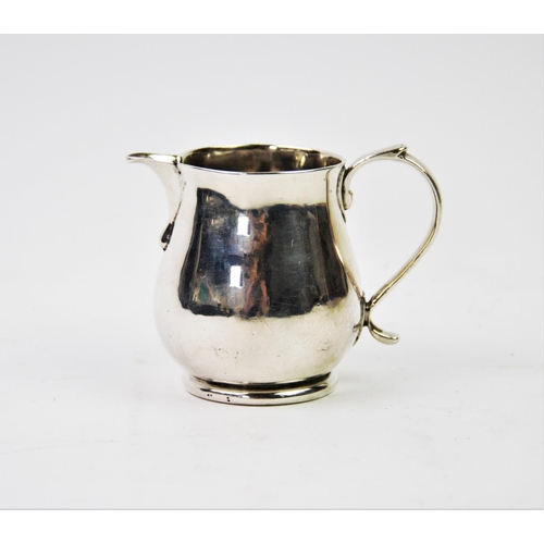 30 - A George I silver cream jug, James Goodwin, London 1718, of plain polished form, with sparrow beak l...