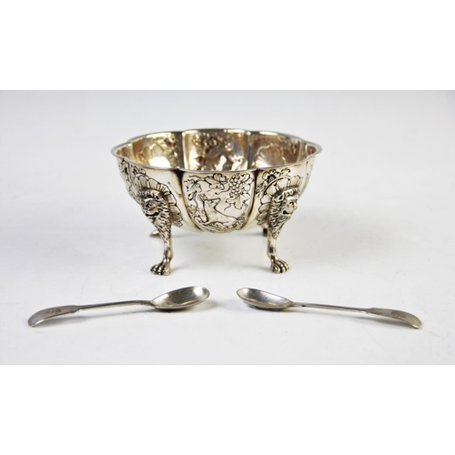 41 - A continental white metal bowl, the floral form bowl, with eight defined panels, decorated with a se...