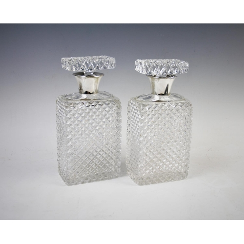 43 - A pair of silver mounted cut glass decanters, John Grinsell & Sons, Birmingham 1939, both of rectang...