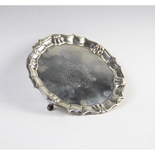 46 - A George II silver waiter, London 1744, with piecrust and shell rim, of plain polished form with cen...