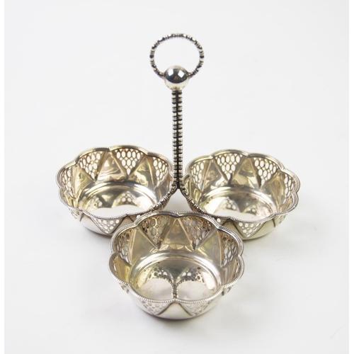 58 - An Edwardian silver centrepiece, Synyer & Beddoes, Birmingham 1913, designed as three pierced dishes...