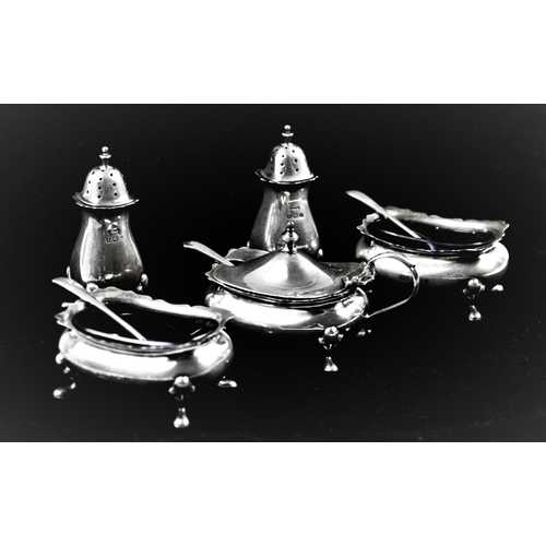 6 - A George V silver condiment set, Walker & Hall, Birmingham 1925, comprising: a pair of pepperettes, ...