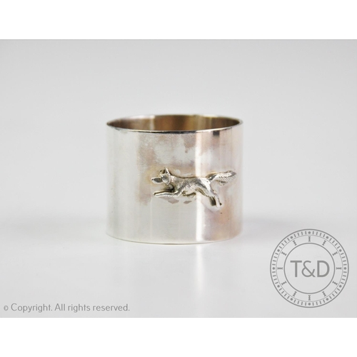 11 - HUNTING INTEREST: A George V silver napkin ring, Adie Brothers Ltd, Chester 1933, designed with appl...