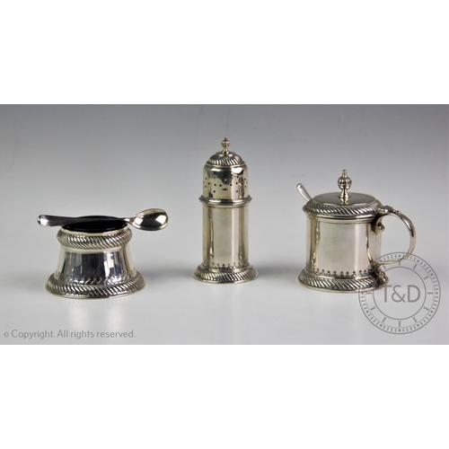 13 - A  silver condiment set, William Comyns & Sons Ltd, London 1937, comprising; a pepperette, wet musta...