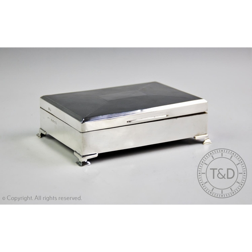 14 - A George V silver cigarette box, W T Toghill & Co, Birmingham 1935, of rectangular form, hinged cove...